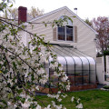 Curved Eave Home Attached Greenhouse